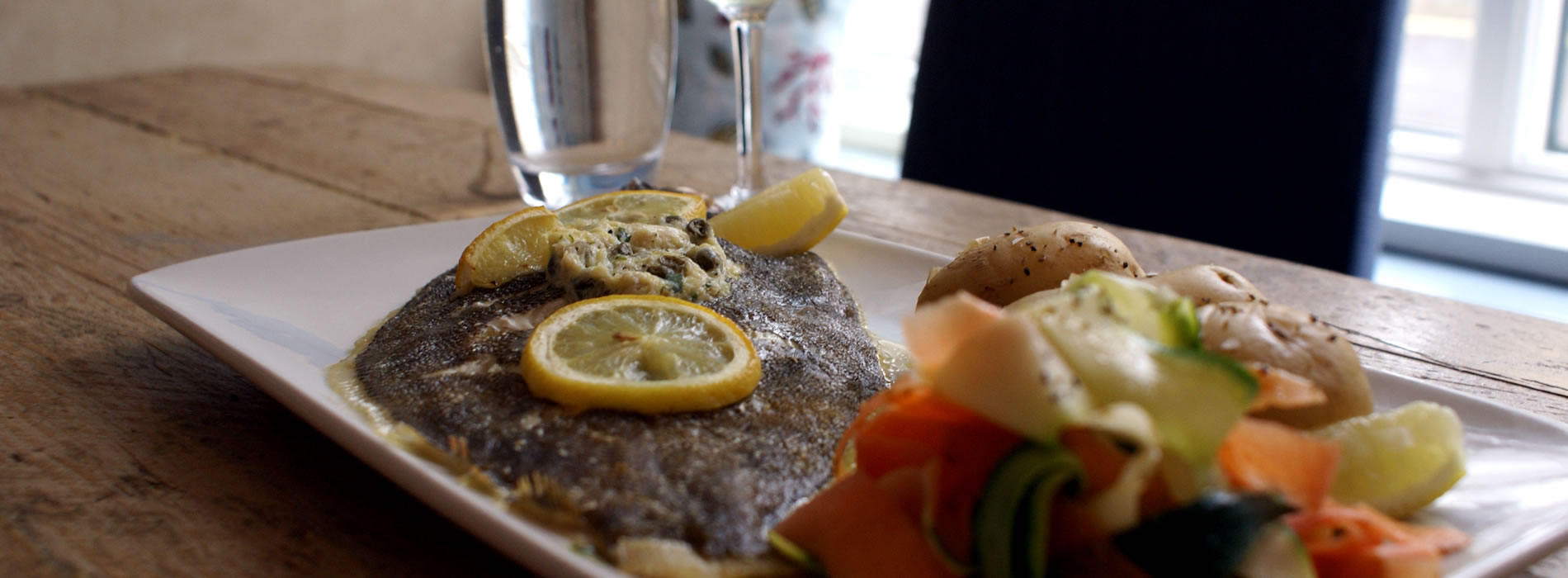 Dover Sole and vegetables on plate