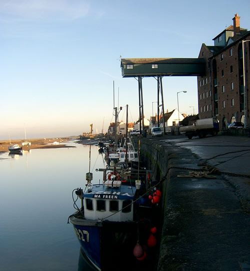 Wells Quay with fishing boats tied up at sunset