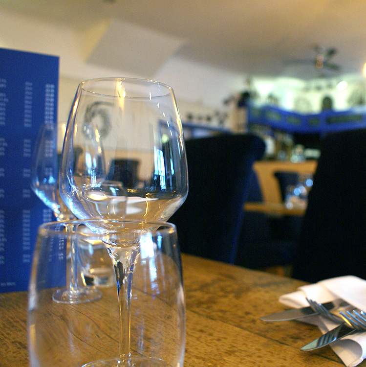 Glass of Wells Crab House house white, one of our wines chosen to compliment our menu